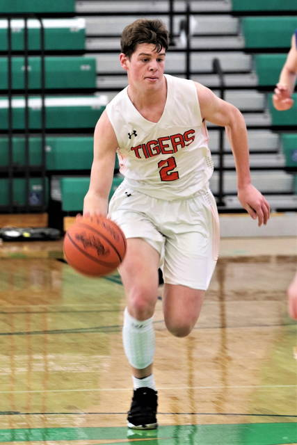 Versailles senior guard Jared DeMange brings the ball up court during a Division III district final on Saturday at Northmont High School's Thunderdome. DeMange led the squad with 22 points.