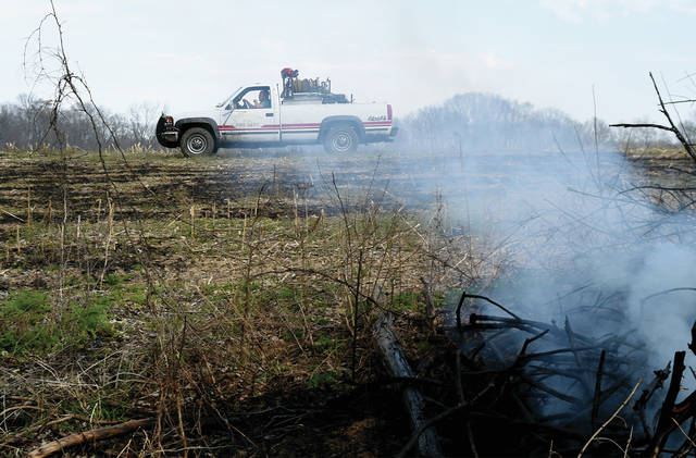 Lockington Volunteer Fire Department's grass truck works at the scene of a field fire on North Hardin Road between state Route 66 and Miami-Shelby Road on Monday afternoon. Piqua, Lockington and Covington fire departments responded to the fire that burned several acres of corn stubble and brush. At the same time, Troy and Casstown fire departments battled a small grass fire on Piqua-Troy Road.