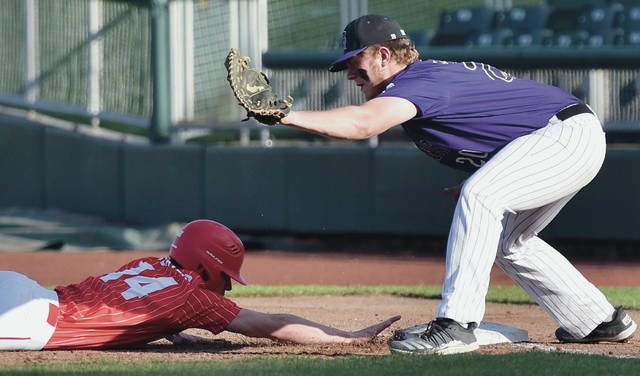 Houston's Luke Beaver dives back to first before Fort Recovery's Kendrik Wendel can tag him during a nonconference game on Friday at Day Air Ballpark in Dayton.