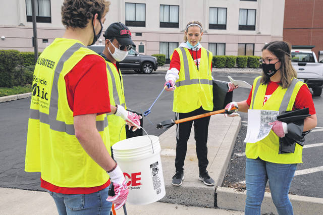 Volunteers at the We Love Lima Trash Pickup project organized by Ohio State Lima social work students pick up trash near Elizabeth Street in Lima. Lauren DiLullo, of Sidney, on the right, is a student at OSU-Lima and helped with the event.