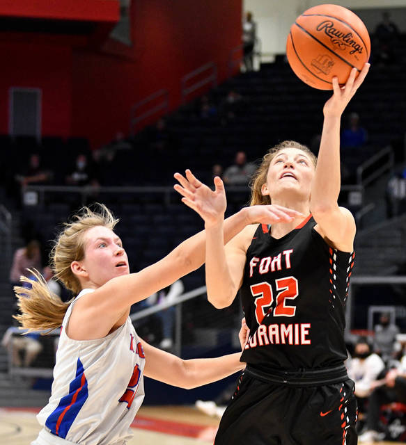 Fort Loramie senior forward Kenzie Hoelscher shoots with pressure from Convoy Crestview's Olivia Cunningham during the second half of a Division IV state semifinal on March 11 at University of Dayton Arena. Hoelscher was named second team all-Ohio in Div. IV.