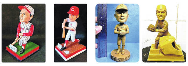 Here are four custom bobbleheads in various stages of being produced that Jay McCollum has developed.