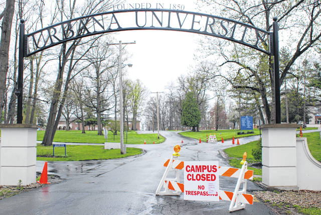 This view on April 30, 2020 shows roadblocks, signs and warnings to trespassers outside an entrance of Urbana University. The institution was closed last year.