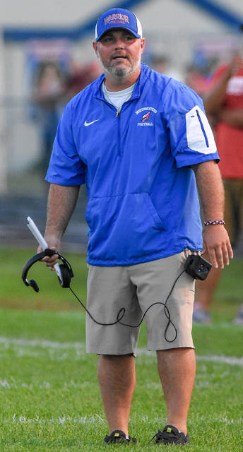 Seth Whiting, who has hired as Minster's new football coach earlier this week, walks off the field after arguing with an official over a penalty while coaching for Springfield Northwestern during a game against Northeastern on Sept. 5, 2015 at Taylor Field in Springfield. He coached at Northwestern for four years and led the program to its first winning season in seven years and its second in 40 years.