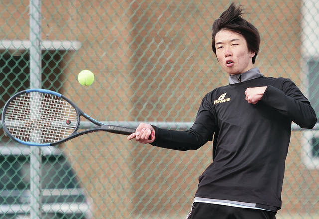 Sidney's Hideyuki Rach competes in a number one doubles match against Tippecanoe at Sidney on Thursday. Rach's partner was Takuma Furukawa.