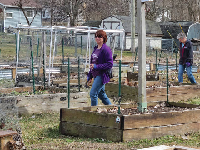 Michelle Stephenson gets ready for a productive work day at the People's Garden.
