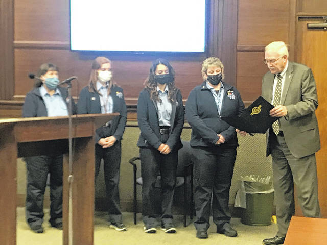 Sidney telecommunicators Karen Christman, left to right, Abbey Goins, Kiarra Ibarra and Renee McDowell are presented the proclamation Mayor Mike Barhorst is reading at Monday evening's Sidney City Council meeting. Telecommunication technician week is recognized April 11-17, 2021.