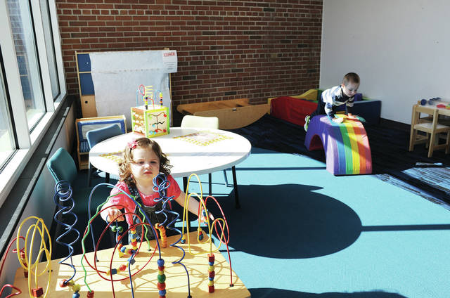 Luna Rivera, left, 1, and Gus Martin, 4, both of Sidney, play in the Early Literacy Room at the Amos Memorial Public Library on Friday, April 2. It was the first day kids could play in the room since it was closed in March 2020 due to the COVID-19 pandemic. With extra cleaning measures in place, the Early Literacy Room is now open to children ages 5 and under accompanied by an adult by appointment only. A time slot can be reserved in person or by calling April Osborne at 937-492-8354 ext. 103. Luna is the daughter of Missy and Javier Rivera. Gus is the son of Brittany Martin.