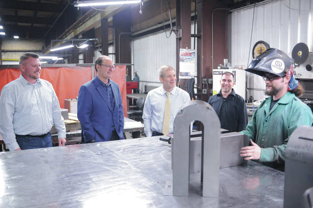Mason Perkins, far right, of Troy, stops welding for a moment to talk with, left to right, Valence Industrial Business Project Manager Josh Price, of Sidney, Valence Industrial CEO Chuck Pisciotta, of Columbus, U.S. Rep. Jim Jordan and Valence Industrial General Manager Chuck Warner, of Sidney, at Valence Industrial on Monday, April 5.