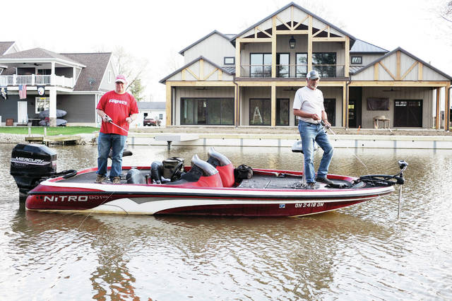 Jim Faulder, left, of DeGraff, and Bob Smith, of Minster, take part in a Lake Loramie fishing tournament on Tuesday, April 6. The fishing tournament was organized by Smith who holds a fishing tournament that meets at the Luthman boat ramp every Tuesday. The tournament runs from 5 p.m. - 9 p.m..