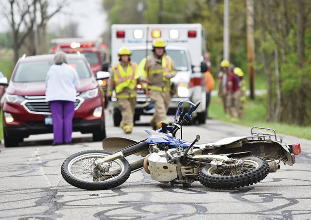 A dirt bike lies in the middle of Stoker Road a short distance west of Stoker Road's intersection with Dawson Road after a hit skip accident shortly before 4 p.m. on Wednesday, April 28. Responding to the accident were the Houston Fire Department, Shelby County Sheriff's Office and Spirit Medical Transport.