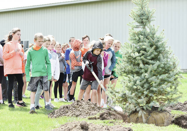Parker Maltinsky, 10, of Minster, son of Kim and Paul Maltinsky, shovels soil around a blue spruce during an Arbor Day planting ceremony held by the Minster 4th grade class at Four Seasons Recreational Park on Friday, April 30. The students each had a chance to help shovel dirt and were then given the seedling of an oak tree. Village of Minster Parks and Recreation Superintendent Ryan Geise talked to the students and helped them plant the blue spruce.