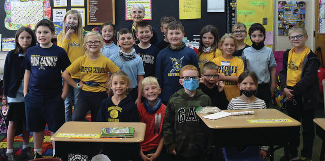 Sister Mary Alice Haithcoat, back row in center, poses for a photo with her class at Piqua Catholic School last week as her students help her celebrate her 50th anniversary as a teacher.