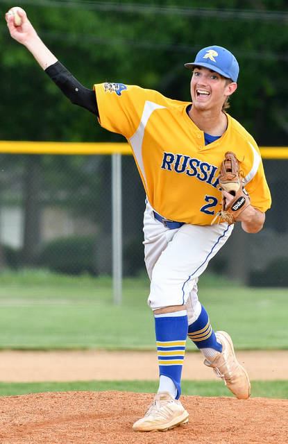 Russia junior Grant Saunders throws a pitch during the seventh inning of a Division IV district semifinal against Botkins on Monday in Versailles. Saunders pitched a complete game and gave up one hit while striking out 13 batters.