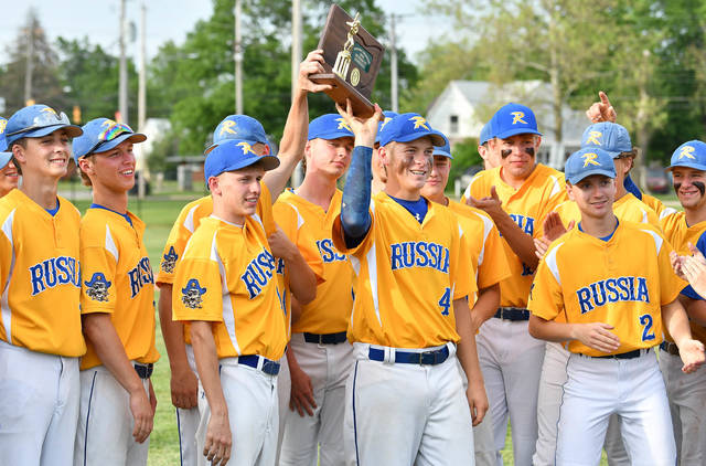 Russia players celebrate after being presented with a Division IV district championship trophy following a 4-0 win over Felicity-Franklin on Thursday at Dixie High School in New Lebanon. The Raiders will face Lancaster Fisher Catholic in a regional semifinal on Thursday at Cincinnati Princeton High School.