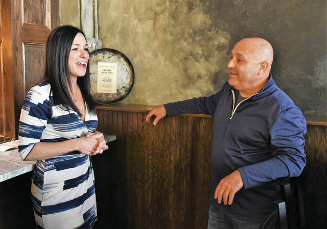 Owner of Amelio's Toni Thorne, left, of Sidney, chats with her dad, Steve Fusco, of Ruskin, Florida, inside Amelio's.