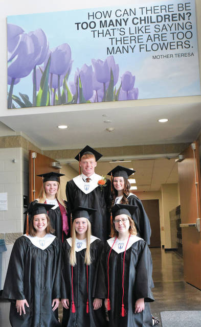 Stopping for a group photo before their Jackson Center High School graduation ceremony are back row, left to right, Valedictorians Regan Davidson, Aidan Reichert and Hope Booser. Front row, left to right, Salutatorians Kiley Lemly, Kennedy Jackson and Mikayla Hensley.