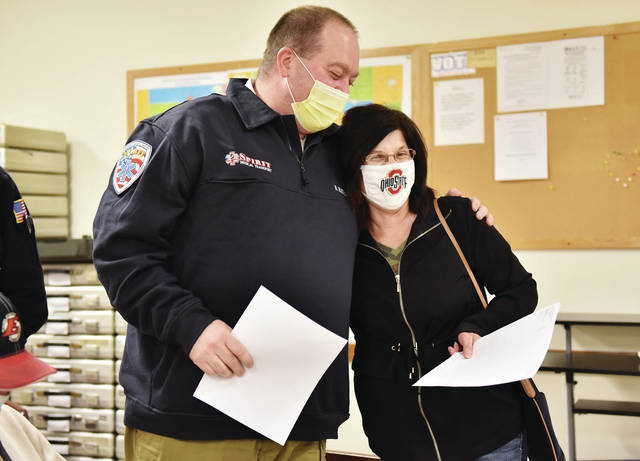 President and CEO of Spirit Medical Transport Brian Hathaway, left, of Greenville, and Chairman of Houston Joint Ambulance District Kim Vondenhuevel, of Sidney, hug after it was announced that the Houston joint ambulance district levy passed.