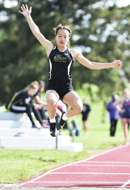 Sidney freshman Kiara Hudgins competes in girls long jump during the Miami Valley League track meet on Thursday at Troy Memorial Stadium. Hudgins finished fourth with a leap of 15 foot, 10 inches.