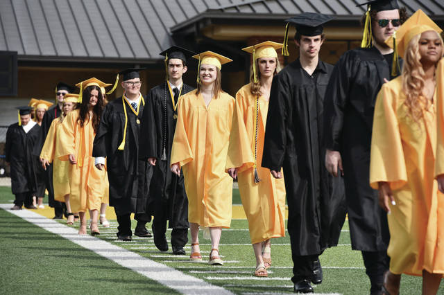 Sidney High School seniors enter the Sidney Memorial Stadium during the commencement of the Sidney High School class of 2021 at Sidney Memorial Stadium on Saturday, May 22.