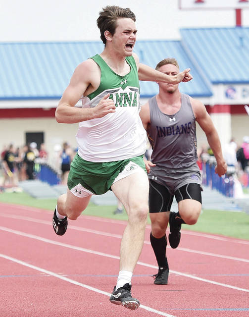 Anna's Justin Richards competes in the boys 100-meter dash during the Division III district meet on Saturday at Alexander Stadium in Piqua. Richards finished second and earned a regional berth and also earned berths in the 200-meter dash and long jump.