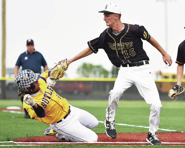 Sidney's Ryan Caulfield tags out Vandalia-Butler's Quinton Hall at Newton High School on Tuesday.