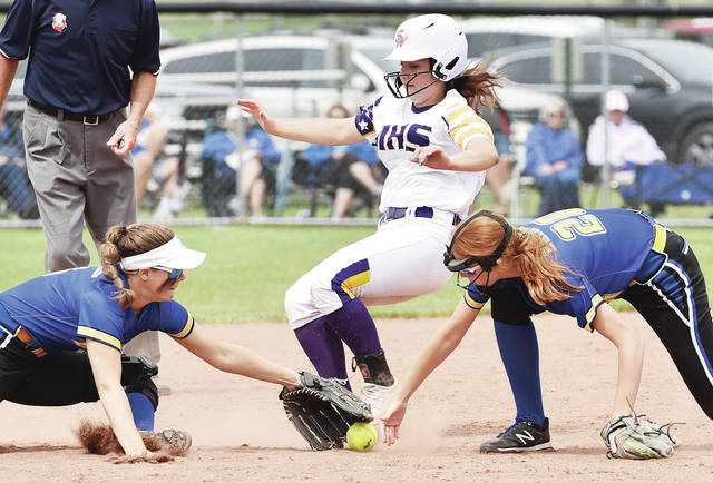 r 5, 20 m2 Russia's Kendall Monnin, left, and Saige Hoying go for a loose ball as Mechanicsburg's Jasalyn Sartin runs towards second at Stebbins Field in Greenville on Wednesday.