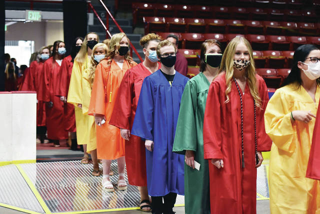 Upper Valley Career Center students process into the Hobart Arena floor during the UVCC graduation in Troy on Thursday, May 27.