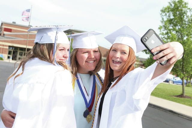 Taking a selfie before the start of their Fairlawn High School graduation are, left to right, Zoey Douglas, Ashley Roush and Alexia Graves.