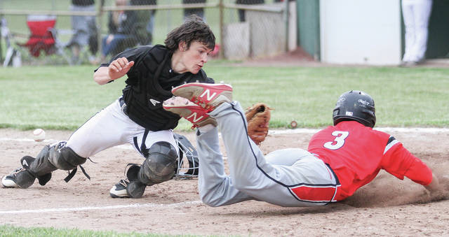 Fort Loramie catcher Darren Hoying tries to tag Tri-County North's Wyatt Hutchins during a Division IV district final on May 18, 2018 at Duke Park in Troy. The Redskins, which won the D-IV state title in 2018, earned a top seed for the second consecutive season.