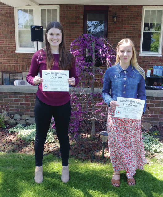Elise Bell, 17, left, of Sidney, and Adeline Heath, 14, right, of West Alexandria, performed in the 2021 National Piano Playing Auditions held in Bellefontaine on April 27.