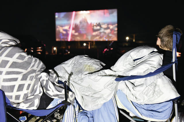People huddle under blankets for warmth as they watch Godzilla vs Kong at the Sidney Auto Vue Drive-In on Saturday, May 1. Tom and Jerry The Movie was also played during the season opening which was Friday.