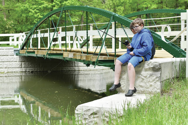 Northwood Intermediate School 4th grader Bradley King, 10, of Sidney, son of Amanda King, prepares to cast his fishing pole at Amos Lake in Tawawa Park on Tuesday, May 18. King was one of the 4th graders that was brought out to the lake through the combined efforts of the Bent Finger Foundation, the Shelby County Historical Society and the Shelby County Antique Power Association. The students completed a soil and water curriculum provided by the Bent Finger Foundation. The kids also listened to a talk by a Sidney park ranger.