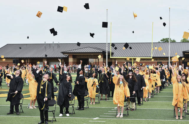 Students toss their caps at the end of the commencement for the Sidney High School class of 2021 at Sidney Memorial Stadium on Saturday, May 22.
