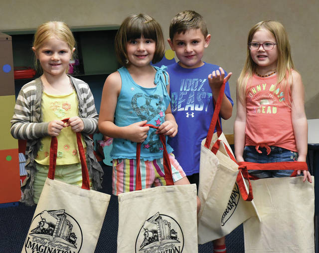 Taking part in the Dolly Parton's Imagination Library at Botkins Branch Library are, left to right, Holly Kreitzer, daughter of Nathan & Kim Kreitzer, Joey Martin , daughter of Blaine and Brandy Martin and James Martin, son of Blaine and Brandy Martin, all of Botkins, and Josephine Grillot, of New Knoxville, daughter of Troy and Amy Grillot. All Graduates are 5-yrs-old and will receive a book, certificate, and an Imagination Library tote bag.