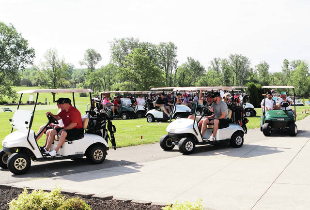 Players take off in golf carts at the start of the Chamber Golf Classic at Shelby Oaks on Tuesday, May 25.