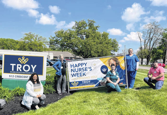 Several members of the Troy Rehabilitation & Healthcare Center caregiving staff gather at the start of several May appreciation events at the skilled nursing facility, including National Nurses Week and National Skilled Nursing Care Week. Troy Rehab held multiple events to show its appreciation for their work during the pandemic.