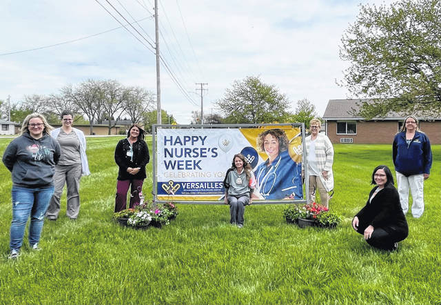 Several members of the Versailles Rehabilitation & Healthcare Center caregiving staff gather at the start of several May appreciation events at the skilled nursing facility, including National Nurses Week and National Skilled Nursing Care Week. Versailles Rehab is holding multiple events to show its appreciation for their work during the pandemic.