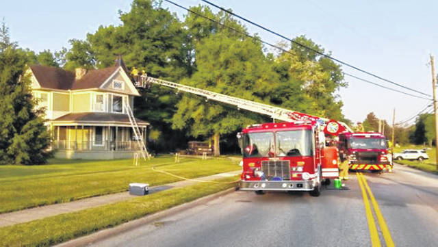 Sidney firefighters attack a structure fire in the attic of 911 E. Court St. on Tuesday morning, May 25. The cause of the fire is under investigation by the Sidney Department of Fire and Emergency Services Fire Investigation Unit.