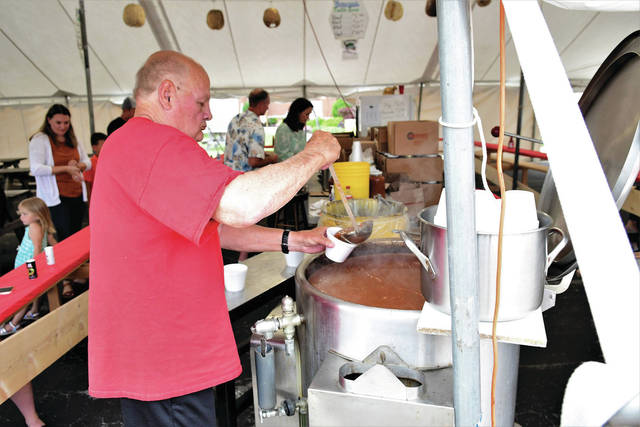 Jerry Bohman pours a cup of Turtle Soup put on by the Legion Post 571 at the Maria Stein Countryfest Friday Night.