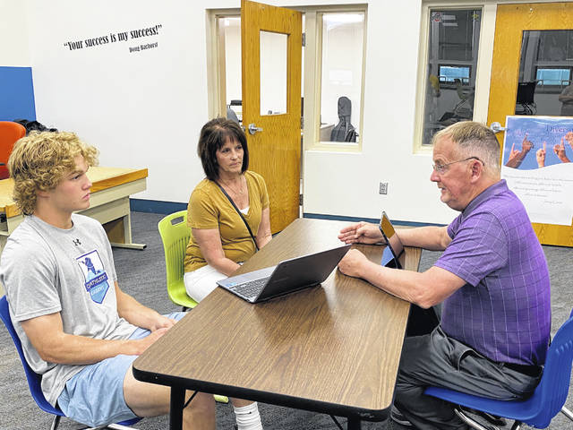 Sidney JaVA administrator Tom Clark meets with senior Aiden Booth and his mother Janice, discussing his virtual course selections for the upcoming school year. Families who are interested in K-12 virtual learning for their child should complete the survey of Interest at www.sidneyjava.org.