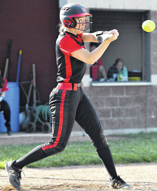 Fort Loramie senior first baseman Clara Gephart swings during a Division IV sectional final against Ansonia on May 13 in Fort Loramie.