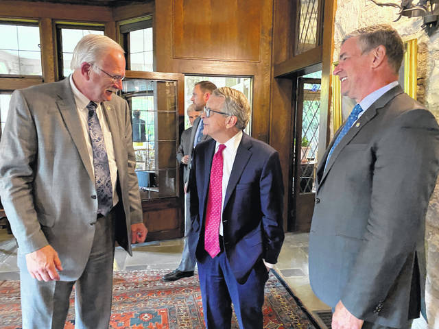 Sidney Mayor Mike Barhorst shares a lighter moment with Ohio Gov. Mike DeWine and Athens Mayor Steve Patterson at a recent meeting at the governor's mansion in Columbus.