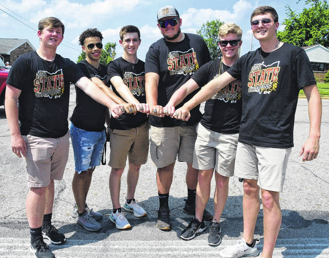 Botkins High School state boys basketball championship team members,m left to right, Tyler Free, Jayden Priddy, Parker Geis, Garrett Greve, Zane Paul and Denton Homan, show off their championship ring Saturday at the Botkins Carousel. A ceremony was held at the Carousel in recognition of the state championship team. The sic were seniors on the team and are members of the Class of 2021.
