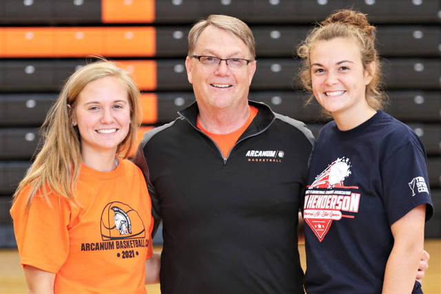 Versailles graduates and sisters Caitlin McEldowney, left, and Kami McEldowney are set to join up to play basketball collegiately at Indiana University-East. They are pictured with father Roger McEldowney, a former Versailles coach and administrator, is currently a teacher and boys basketball coach at Arcanum.