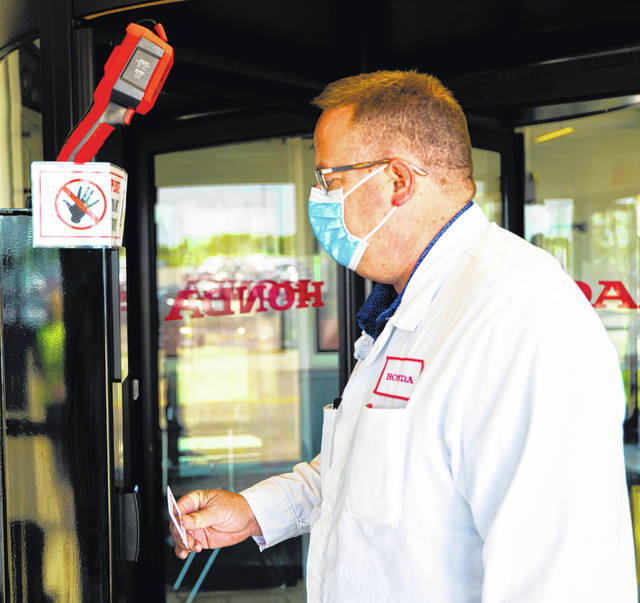 Craig Lloyd, Honda associate chief engineer, facilities department manager, utilizes a thermal scan kiosk at the Marysville Auto Plant in June 2021. Thermal scanners were altered from scanning equipment to scanning human skin to take Honda employees' temperatures in May 2020 during the onset of the COVID-19 pandemic. The scanners will continue to be used until early July 2021.