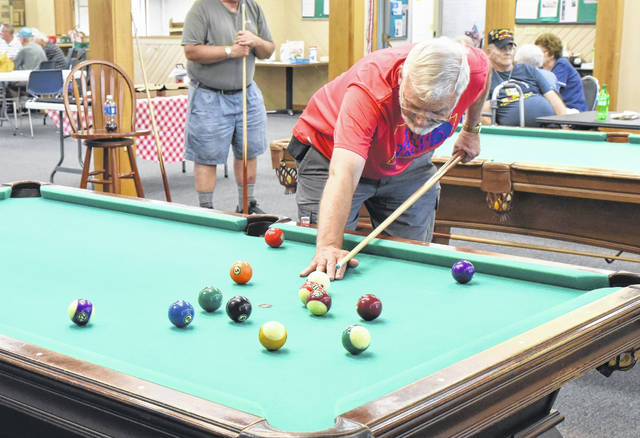 Mike Nolte, of Sidney, competes in the veterans pool tournament held Wednesday afternoon at the Senior Center. Nolte is a three-and-a-half-year veteran of the Navy Seabees.