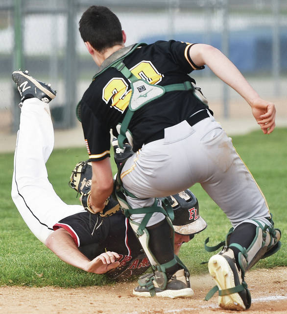 Fort Loramie's Elliott Davis is tagged out by Troy Christian's Camden Koukol trying to reach home during a Division IV district final on May 27 at Versailles High School. The Redskins have stolen 117 bases this year.
