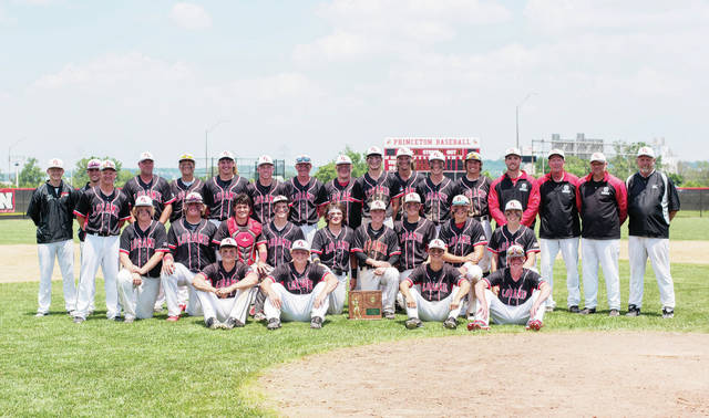 Fort Loramie players pose for a team photo with the Division IV regional championship trophy after defeating Russia 7-1 in a regional final on Saturday at Cincinnati Princeton High School.