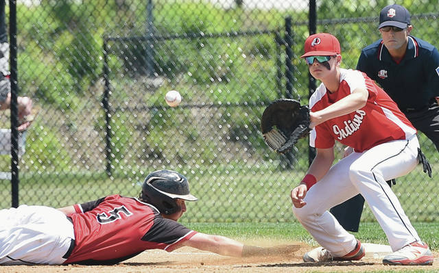 Fort Loramie's Jake Sanders dives back to first base as Cedarville's Braydon Criswell waits for the throw during a Division IV regional semifinal on Friday at Cincinnati Princeton High School.